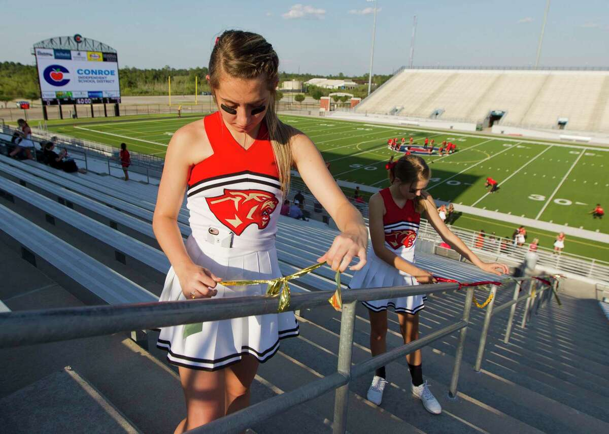 Caney Creek cheerleaders Paris Douday and Hailie Hogge wrap ribbons around the band section before a non-district high school football game at Woodforest Bank Stadium in 2019. Woodforest Bank Stadium has seen many athletic accomplishments since its opening in 2008. This year has been different, however, as the Conroe ISD venue has been used as a COVID-19 testing site and hosted socially-distanced graduations. Things will look more normal Thursday night as Grand Oaks and Caney Creek kick off the 2020 football season at Woodforest Bank Stadium at 7 p.m. under the lights.