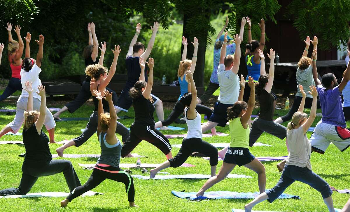 An outdoor yoga class hosted by Yoga Culture at Tarrywile Park in Danbury. Schuck said she does not have any plans to open another brick-and-mortar studio, but will likely continue to teach classes online. Her advice to struggling fitness studio owners right now is to remind themselves they are