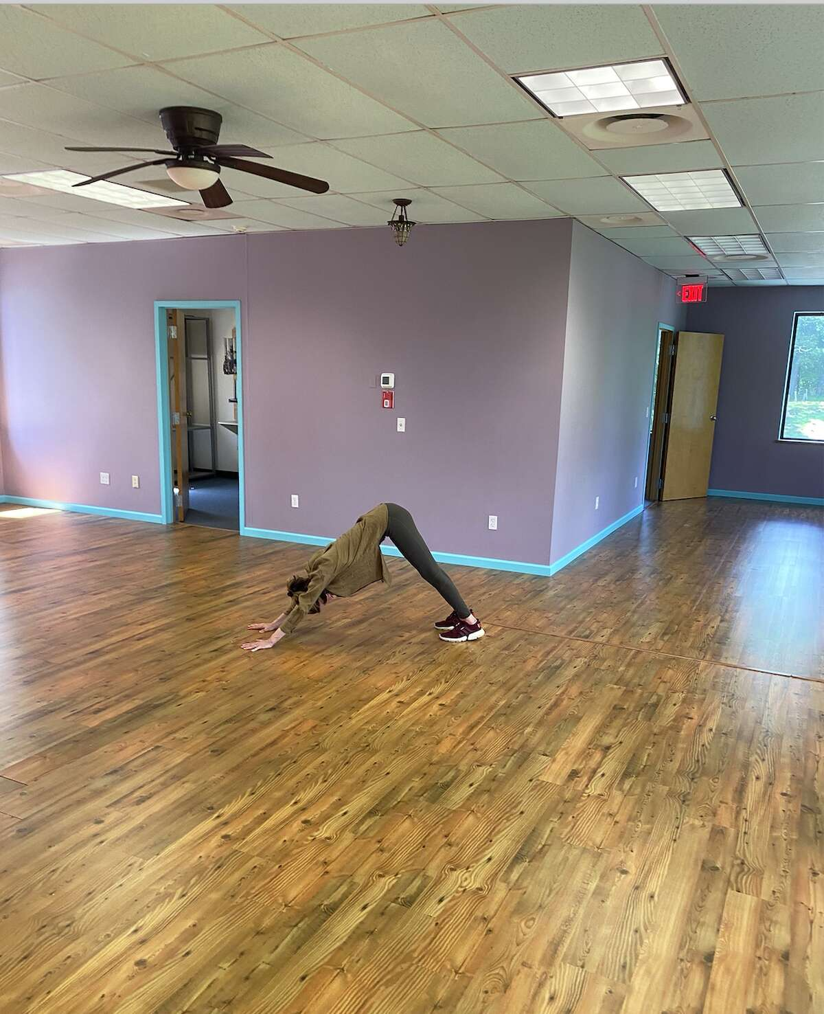 Yoga Culture owner Jenny Schuck does the last downward dog at her studio on Mill Plain Road in Danbury. Yoga culture is shutting its doors on Sept. 26.
