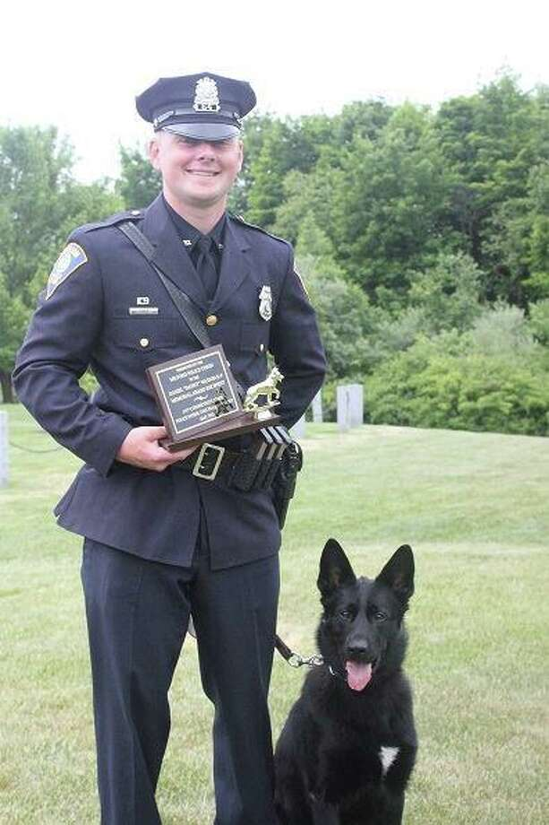 K9 officer Stryker with Officer Dan Loris in a photo posted on the Shelton Police Department Facebook page in 2016. Loris was terminated this past week, and Stryker was retired. Loris purchased Stryker from the department, Police Chief Shawn Sequeira said. Photo: Shelton Police Department / Contributed Photo / Connecticut Post