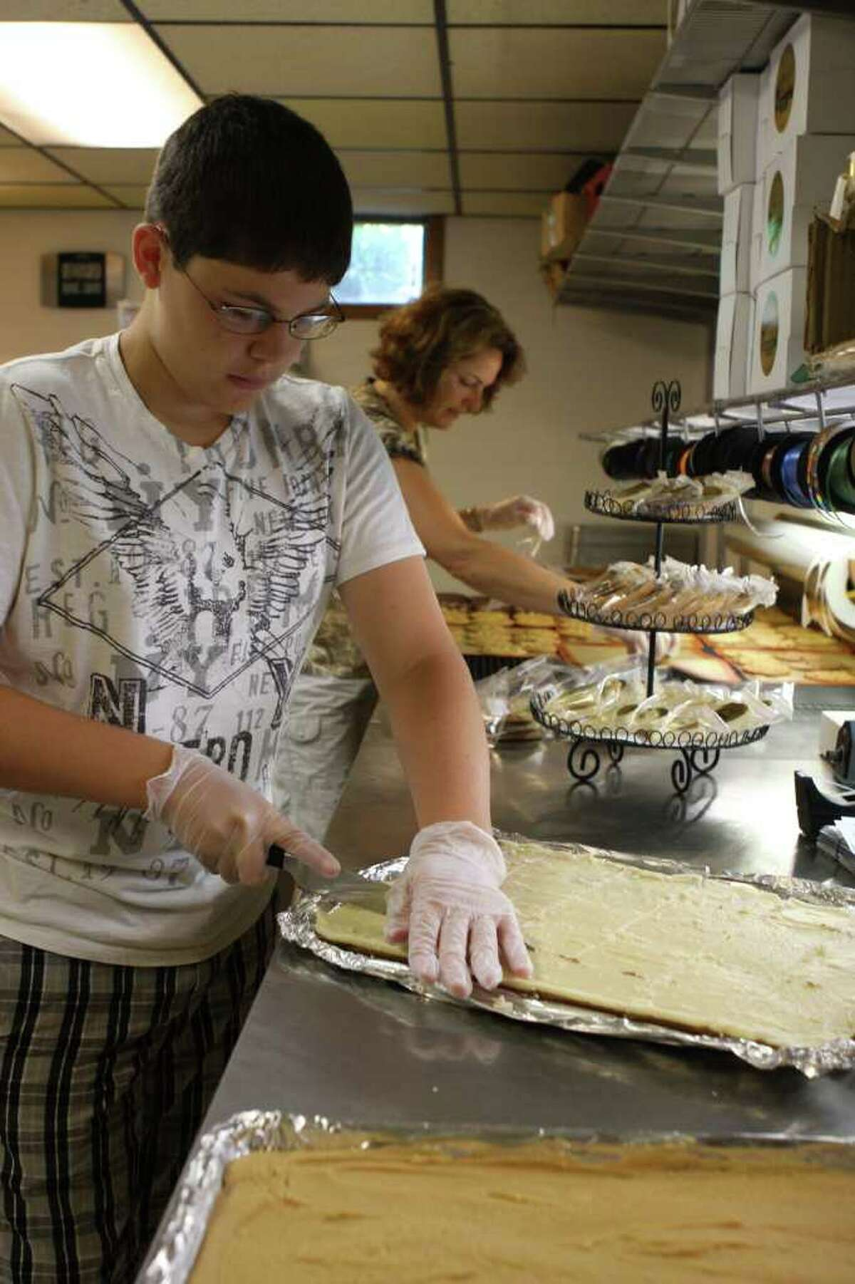 A mother/son operation at Saratoga Cookie Co.: Emily Damiano makes the cookies, while son A.J. Damiano runs a side business producing homemade fudge. (Krishna Hill / life@home)