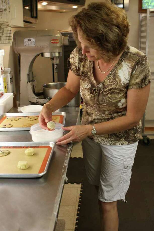Emily Damiano runs Saratoga Cookie Co. from her Malta home. (Krishna Hill / life@home) Photo: Photos By Krishna Hill / Times Union/Life@Home magazine September 2010
