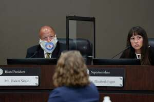 Humble ISD Superintendent Dr. Elizabeth Fagen speaks while Robert Sitton, board president listens during the Humble ISD board meeting to discuss the reopening of schools, Monday, August 3, 2020, in Humble.