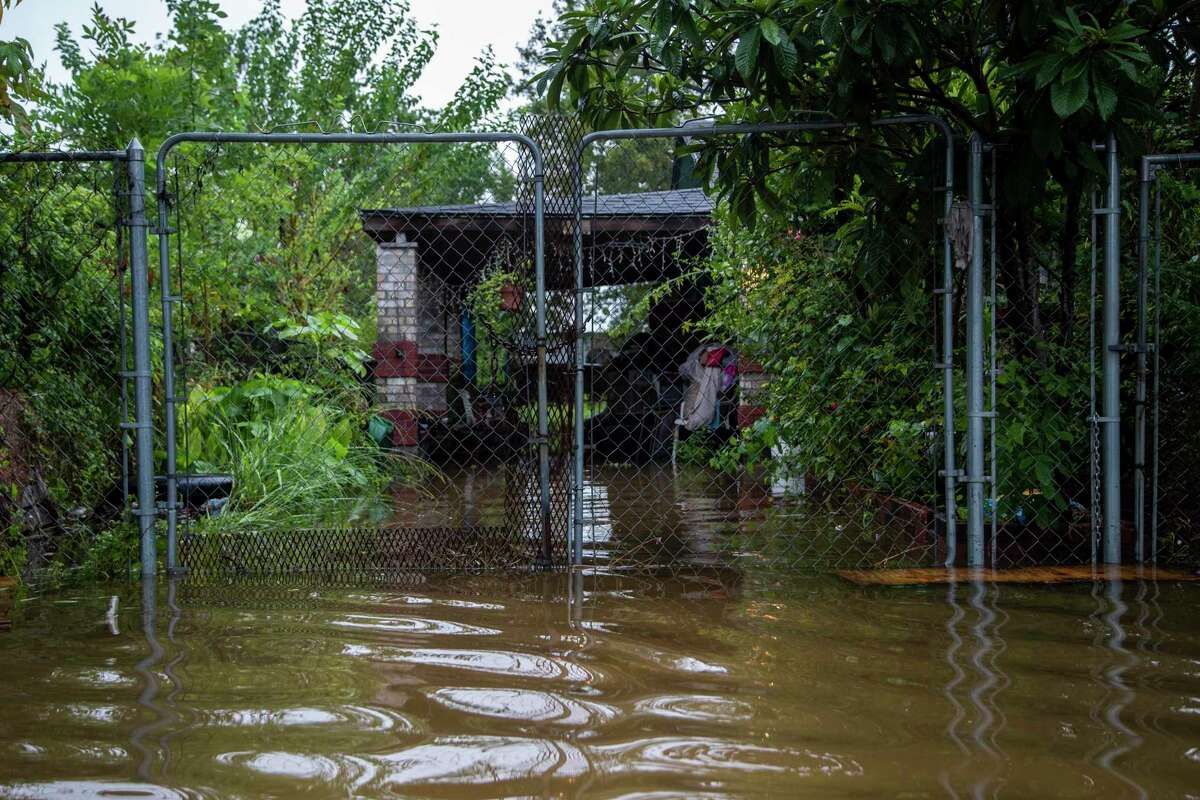 Water from a flood caused by Tropical Storm Beta inundates the driveway of a home on Sam Houston St., Wednesday, Sept. 23, 2020, in Houston.