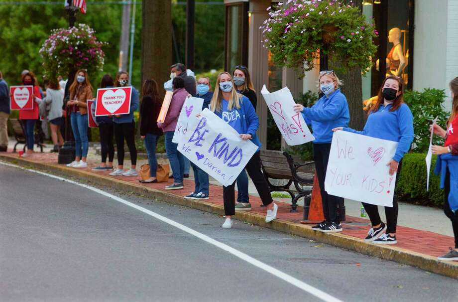 Approximately 125 teackers line Post Road and Leroy Avenue to protest plans to reopen school before the start of a board of education meeting on Leroy Avenue in Darien, Conn., on Tuesday Sept. 22, 2020. The teachers' union in Darien held the rally/protest because they felt their concerns about reopening full-time in person next Tuesday have not been heard. Photo: Christian Abraham / Hearst Connecticut Media / Connecticut Post