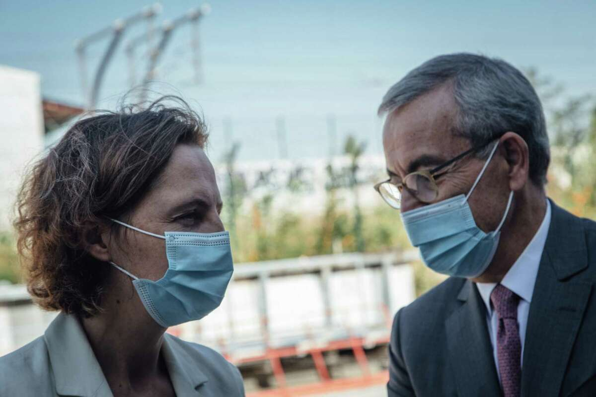 Claire Waysand, interim chief executive office of Engie, left, and Jean-Pierre Clamadieu, chairman of Engie, wear protective face masks in Stains, France, on Sept. 22, 2020.