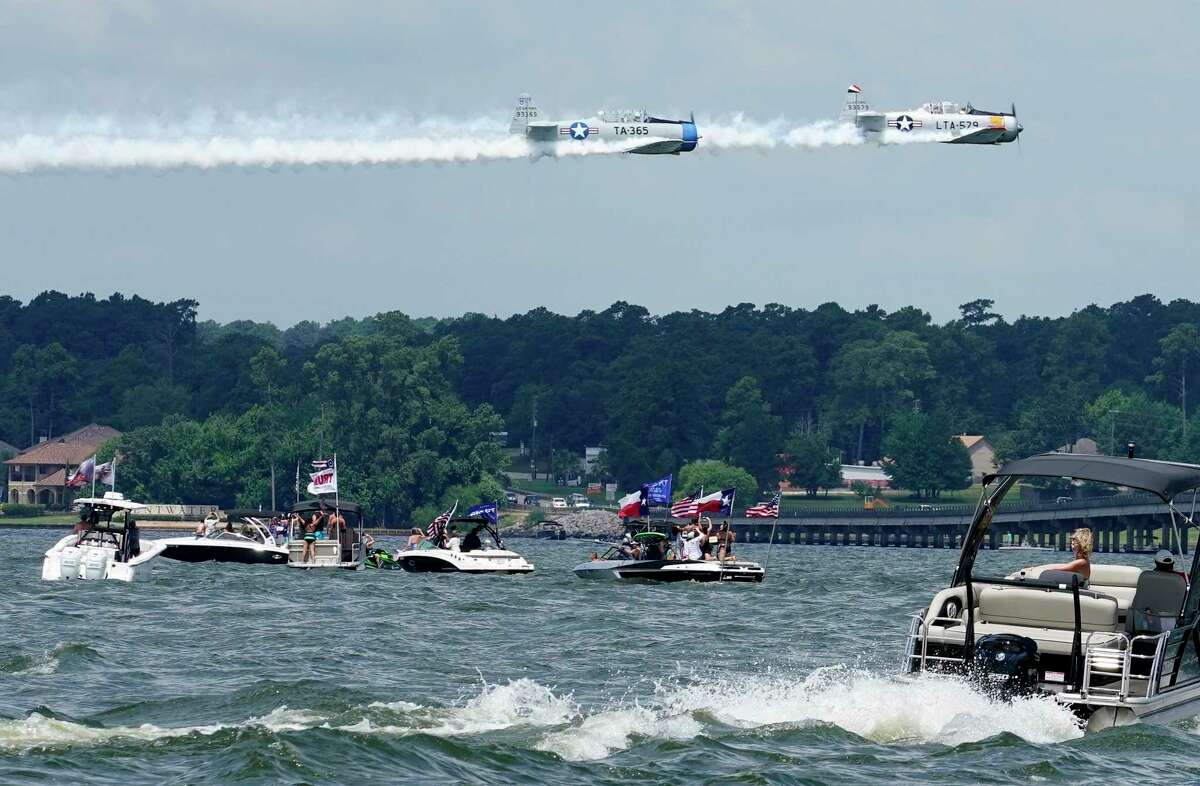 Two North American AT-6 aircraft fly over boaters participating in the Trump Boat Parade on Lake Conroe on June 6. With Election Day fast approaching, Lake Conroe will be hosting a voter registration drive for Montgomery County residents on its shore as accompanied by a boat parade and a flyover show. Float the Vote will be held 11:30 a.m.-2 p.m. Oct. 3 on the lake.