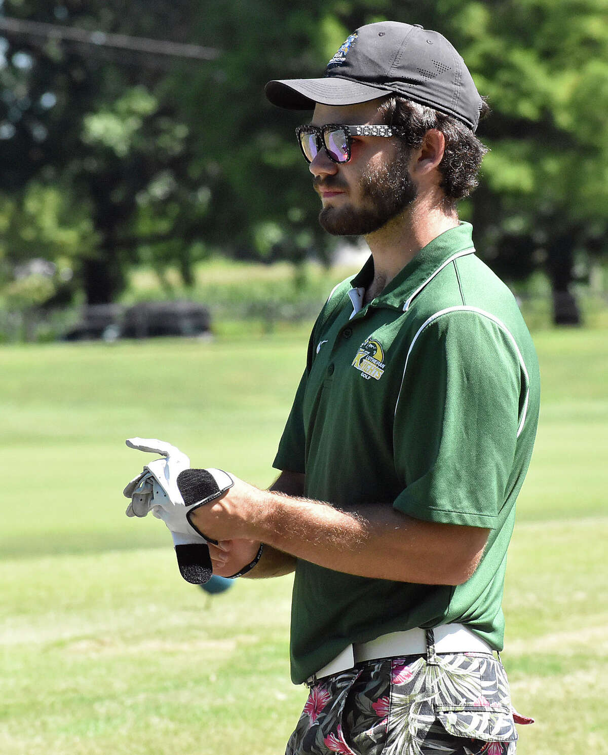 Metro-East Lutheran's Antonio Ybarra scans a hole at Belk Park Golf Course during the Madison County Tournament in August.