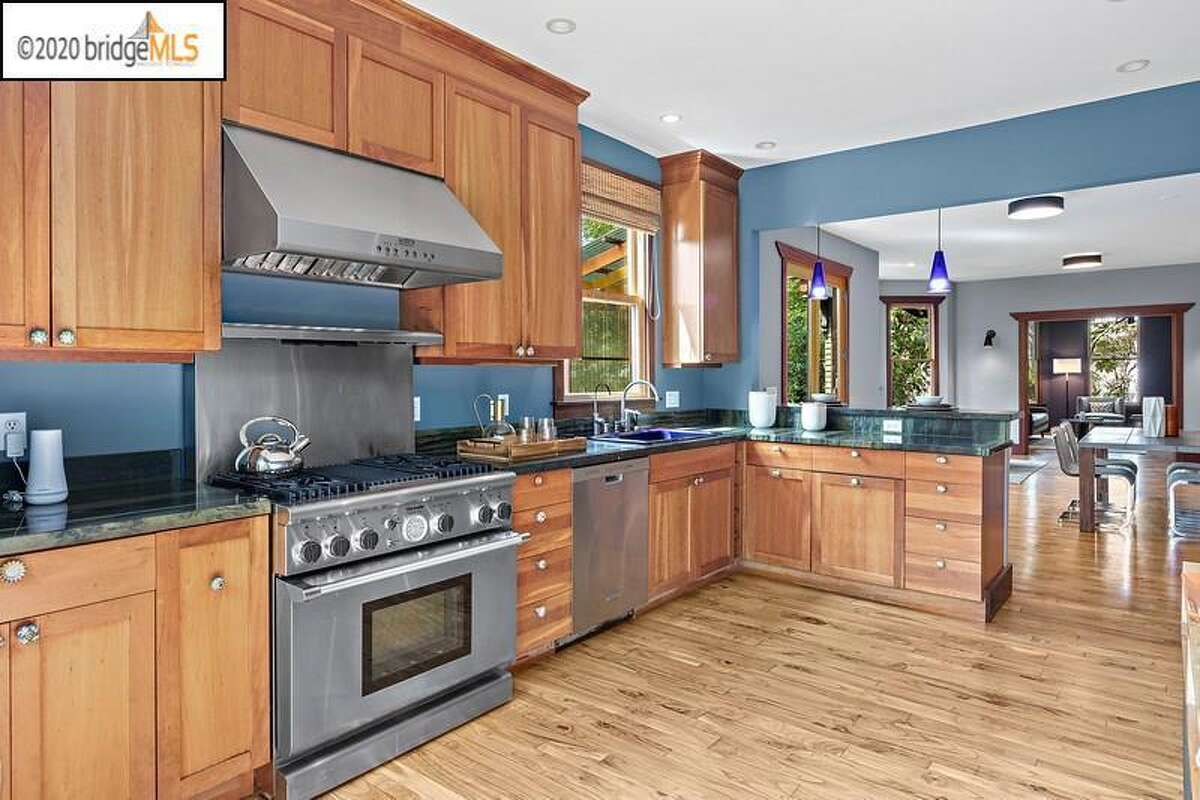 The kitchen is updated and open to the rest of the home, part of a major renovation Bowart undertook after she purchased the then-more traditional Victorian in 2002.