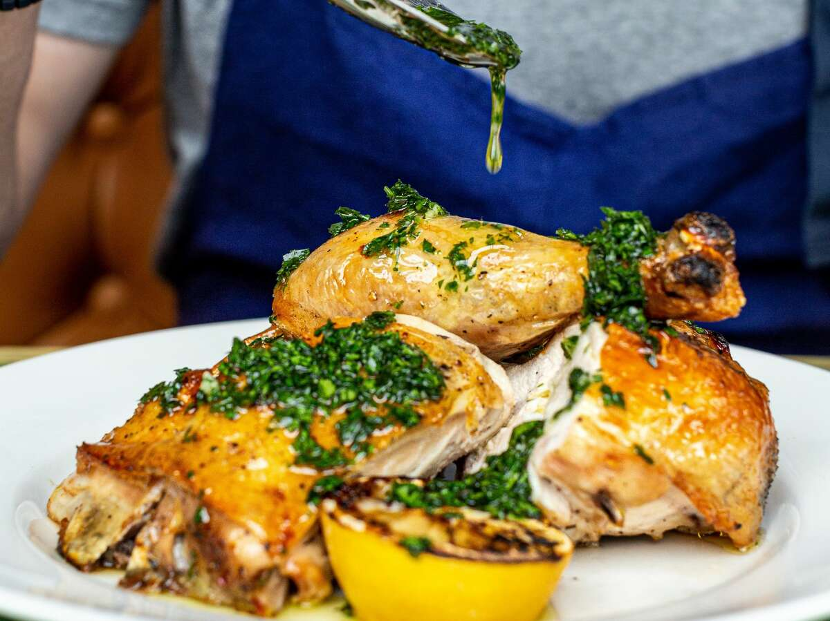 Half-chicken with lemon and herb jus at Ostia.