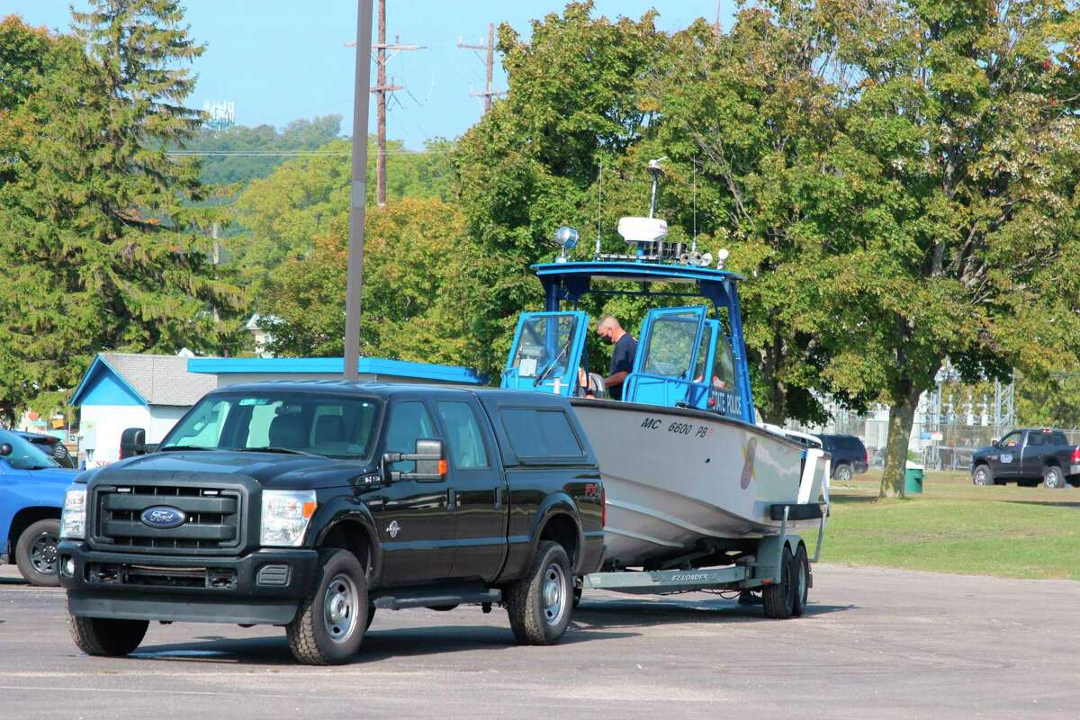 The Michigan State Police load up equipment after taking part in the successful recovery of a boy who was washed off the pier on Sept. 21. (Photo/Colin Merry)