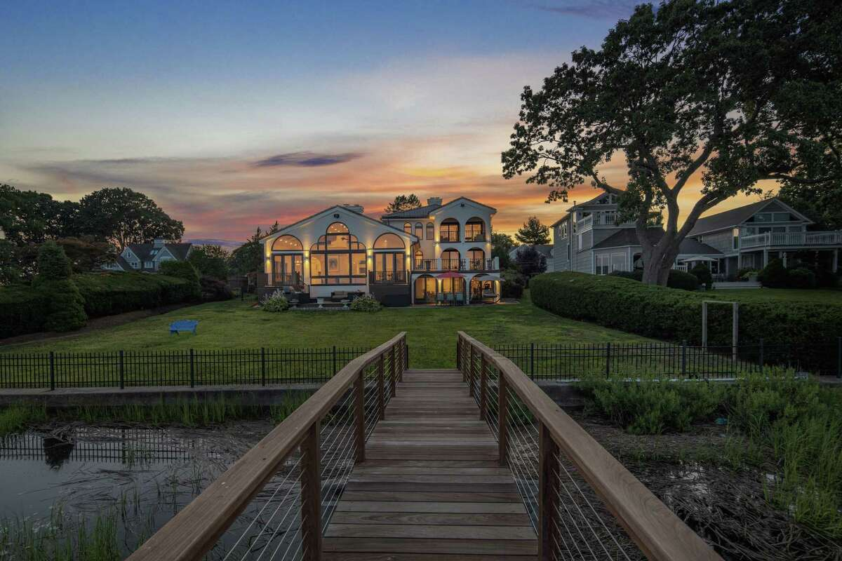 This over-sized property of just over half an acre has a deep water dock.