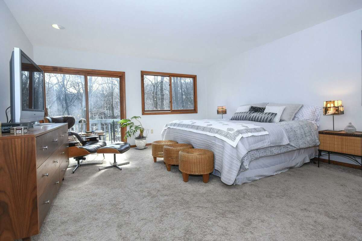 The first floor master bedroom suite features wall-to-wall carpeting, a walk-in closet, private bath, and sliders to its own deck. The bounty of natural resources continues beyond the borders of this property; this section of Weston offering a wealth of preserved open spaces with hiking trails. Nearby are the Grace Robinson Nature Sanctuary, Crow Hill Nature Preserve, Freeborn Walk Trail - all managed by the Aspetuck Land Trust, as well as Devil's Glen Park, the Trout Brook Valley Preserve, the Saugatuck Valley Trail on Aquarian Water Company land, and others. In addition to hiking trails some of the local preserves offer mountain biking, cross country skiing and bridle trails. And for golfers there are two courses within close proximity: the Connecticut Golf Club in neighboring Easton and the one at the Aspetuck Valley Country Club.