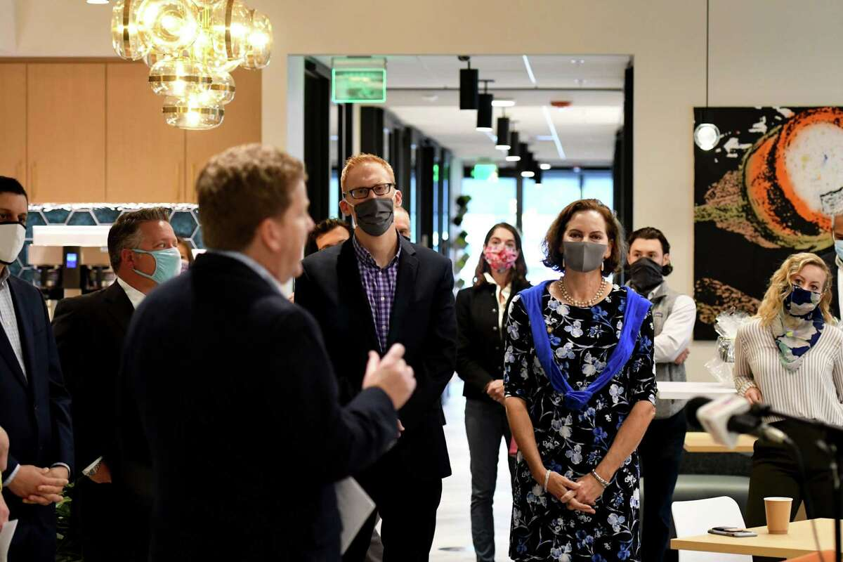 Capital Region Chamber of Commerce CEO Mark Eagan, left, speaks to guests and local leaders during a ribbon cutting for the new Hone Coworks flexible office and coworking space from The Rosenblum Companies on Wednesday, Sept. 23, 2020, in Guilderland, N.Y. (Will Waldron/Times Union)