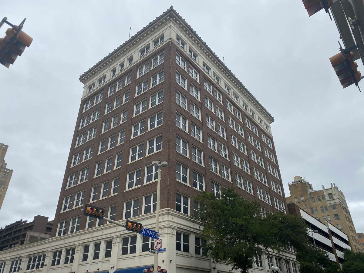 An office building adjacent to the River Walk is set to be converted into high-end apartments.