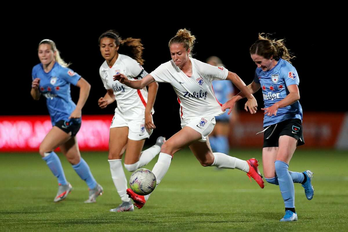 HERRIMAN, UTAH - JULY 18: Celia Jimenez #13 of OL Reign FC runs with the ball against Michele Vasconcelos #7 of Chicago Red Stars during the second half in the quarterfinal match of the NWSL Challenge Cup at Zions Bank Stadium on July 18, 2020 in Herriman, Utah. (Photo by Maddie Meyer/Getty Images)