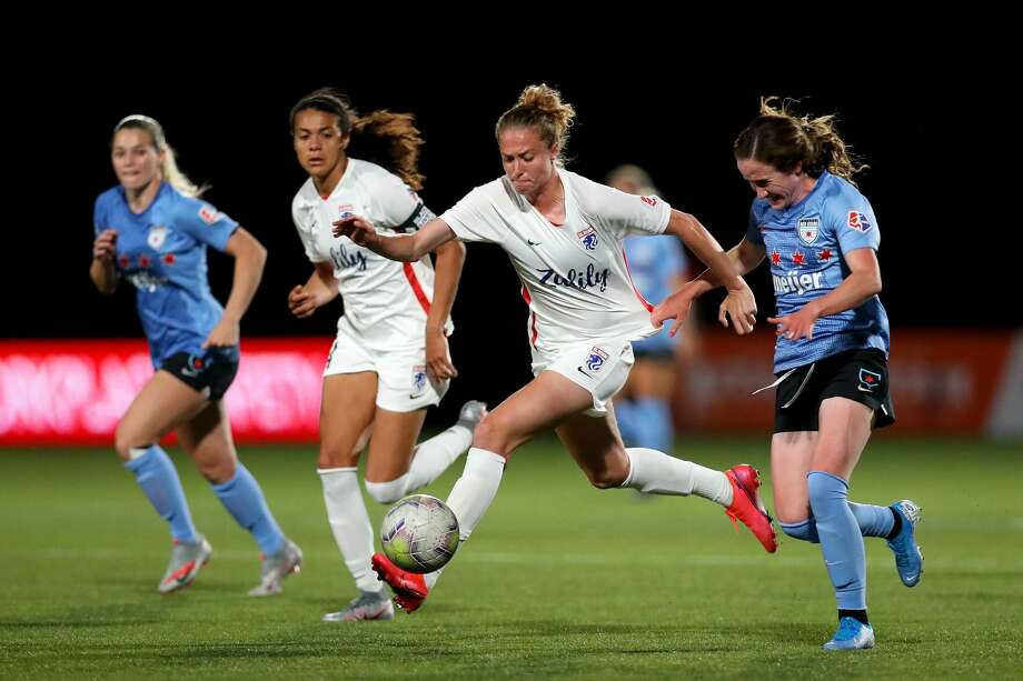 HERRIMAN, UTAH - JULY 18: Celia Jimenez #13 of OL Reign FC runs with the ball against Michele Vasconcelos #7 of Chicago Red Stars during the second half in the quarterfinal match of the NWSL Challenge Cup at Zions Bank Stadium on July 18, 2020 in Herriman, Utah. (Photo by Maddie Meyer/Getty Images) Photo: Maddie Meyer/Getty Images / 2020 Getty Images