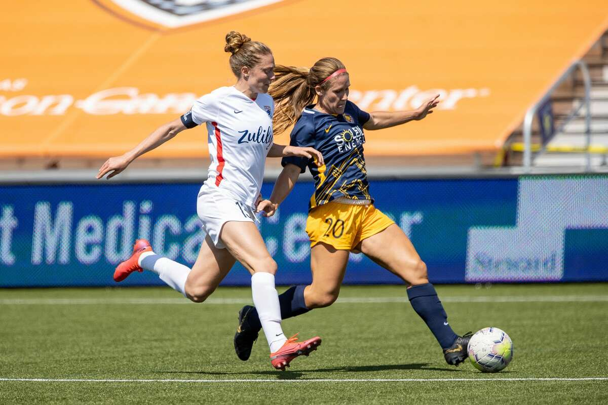 HERRIMAN, UT - JULY 8: Mallory Weber #20 of Utah Royals FC plays for the ball against Celia Jimenez Delgado #13 of OL Reign FC during a game between OL Reign and Utah Royals FC at Zions Bank Stadium on July 8, 2020 in Herriman, Utah. (Photo by Bryan Byerly/ISI Photos/Getty Images).