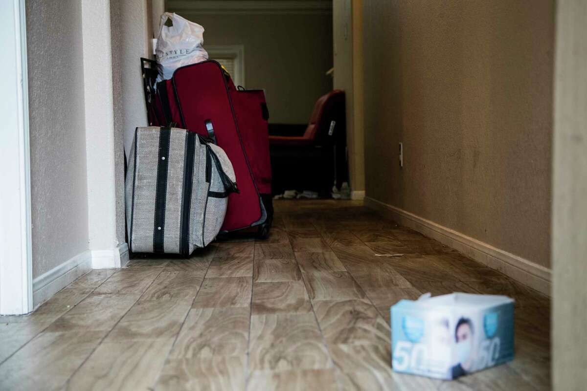 Items visible from the front door of an unlicensed group home, Wednesday, Sept. 23, 2020, in Houston.