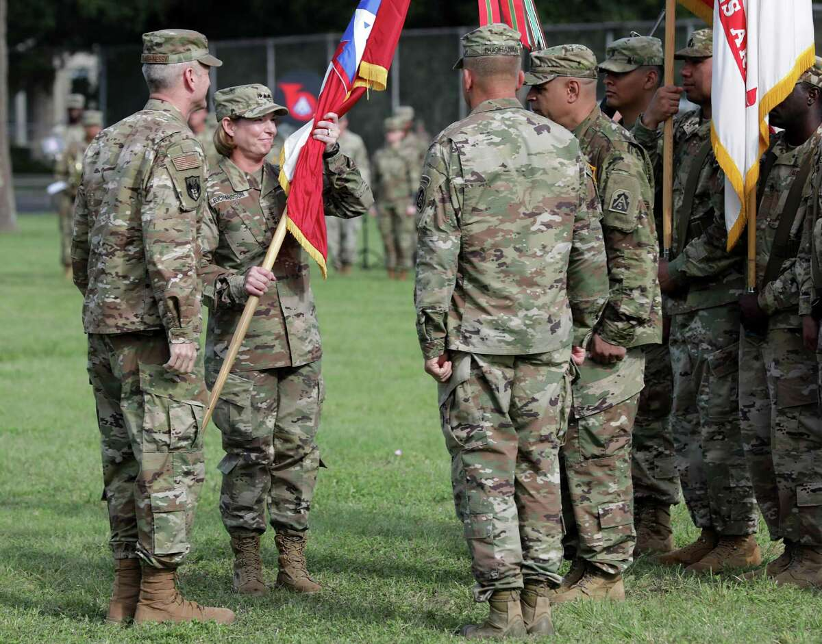 Lt. Gen. Laura Richardson, second from left, receives the command flag from Gen. Terrence J. O'Shaughnessy, left, Commander United States Northern Command and North American Aerospace Defense Command, as Lt. Gen. Jeffrey Buchanan, right, steps down as commander of U.S. Army North during the Change of Command at Fort Sam Houston on July 8, 2019.
