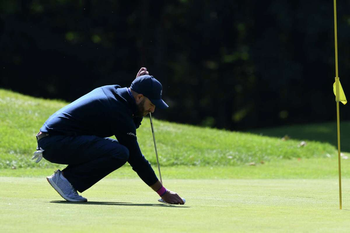 Justin Hearley of Normanside positions for a putt on the fifth green while competing in the final of the Northeastern New York PGA Match Play Championship on Wednesday, Sept. 23, 2020, at Colonie Golf and Country Club in Voorheesville, N.Y. (Will Waldron/Times Union)
