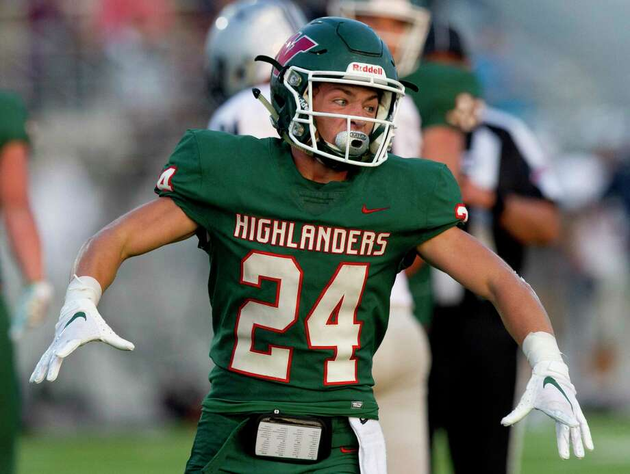 The Woodlands wide receiver Jack Calhoun (24) reacts after an 11-yard touchdown by running back Malik Johnson during the first quarter of a District 15-6A high school football game at Woodforest Bank Stadium, Friday, Sept. 20, 2019, in Shenandoah. Photo: Jason Fochtman, Houston Chronicle / Staff Photographer / Houston Chronicle