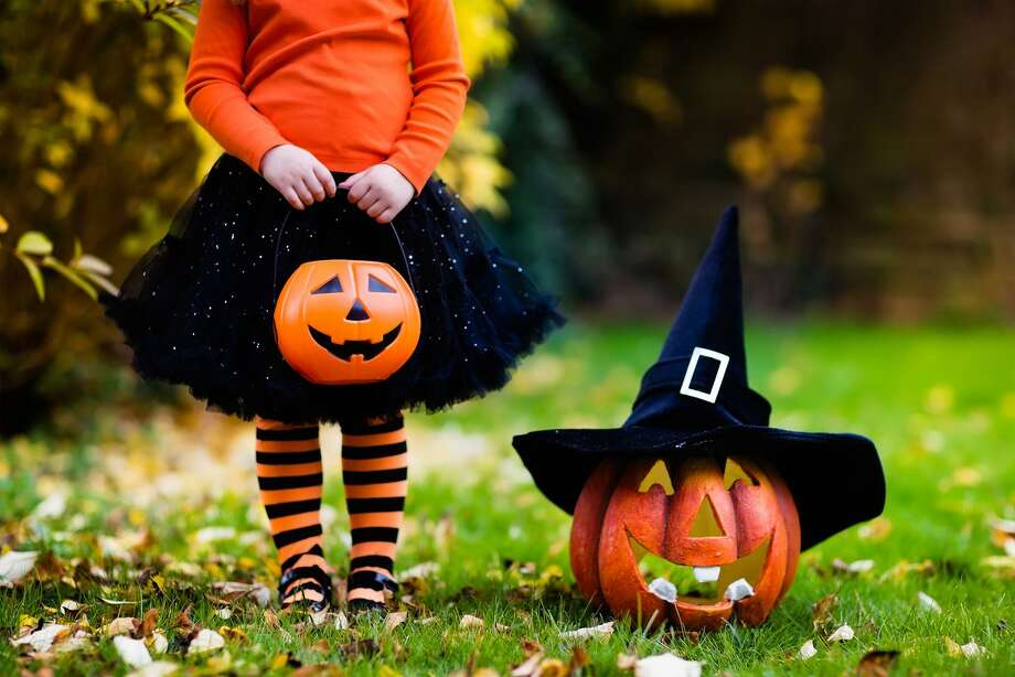 """Due to the coronavirus pandemic, people are advised to avoid door-to-door trick-or-treating, """"trunk-or-treat"""" events and large Halloween gatherings this year. Photo: Dreamstime / TNS / Dreamstime"""
