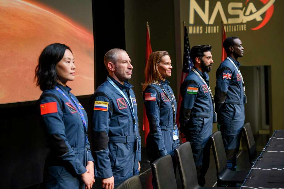 "This image released by Netflix shows, from left, Vivian Wu, Mark Ivanir, Hilary Swank, Ray Panthaki and Ato Essandoh from the new series ""Away,"" premiering on Sept. 4. (Netflix via AP) Photo: Diyah Pera / Associated Press / © 2020 Netflix, Inc."