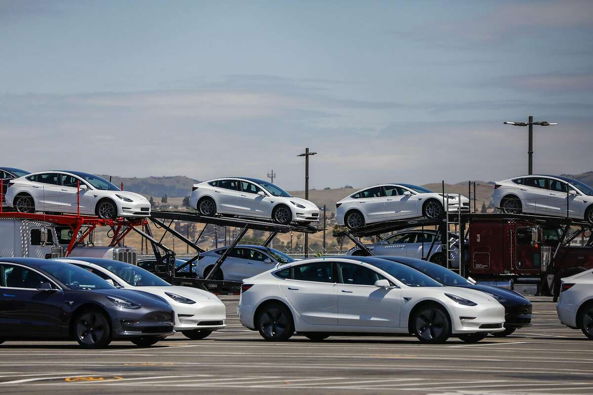 Cars are stacked in the parking lot at the Tesla car factory on Monday, May 11, 2020 in Fremont, California. California Gov. Gavin Newsom said Wednesday, Sept. 23, 2020 that the state will halt sales of new gasoline-powered passenger cars and trucks by 2035. On Wednesday he ordered state regulators to come up with requirements to meet that goal. California would be the first state with such a rule, though Germany and France are among 15 other countries that have a similar requirement.