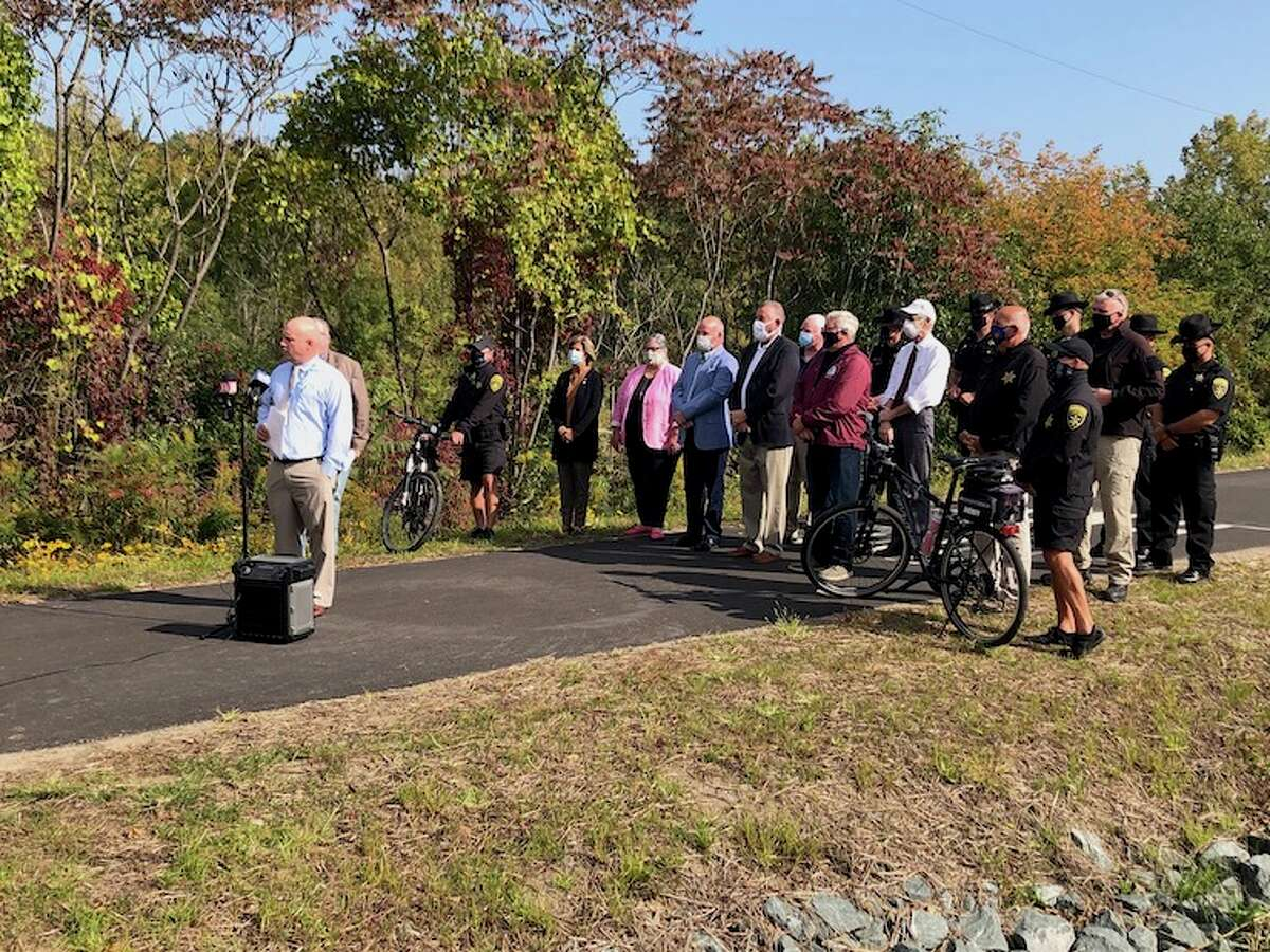 Another 2.5 miles of the Zim Smith Trail has been added to. Officials celebrate the opening on Sept. 23, 2020.