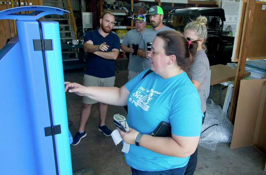 Jessica Bybee tests Blast Pass a new pay system using reloadable cards for food, drink and merchandise in preparation for the annual Conroe Cajun Catfish Festival in 2019. The Blast Pass system will return again this year to aid in contactless paying for food and beverages at the festival. Photo: Jason Fochtman, Houston Chronicle / Staff Photographer / Houston Chronicle