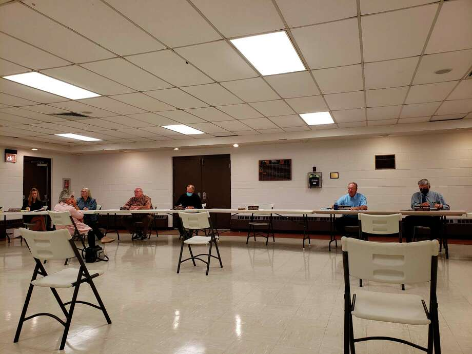 The Huron County commissionersprepare for this week's board meeting. The board had a lengthy closed session at the meeting whereit discussed potential pay increases to certain county employees. (Robert Creenan/Huron Daily Tribune)