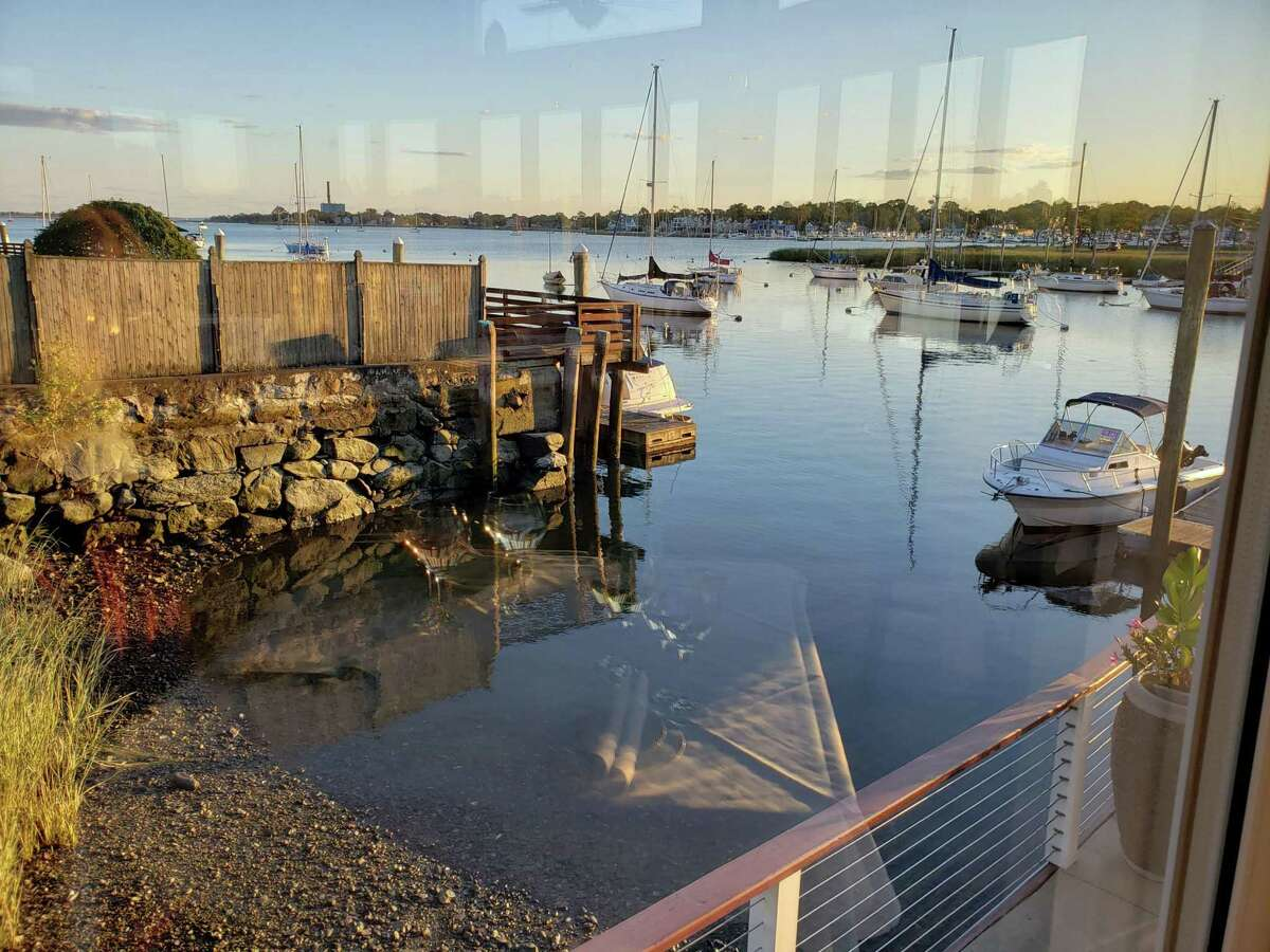 Every table at Harbor Lights looks out over moored boats, salt marsh grass, and the Norwalk harbor's broad channel.
