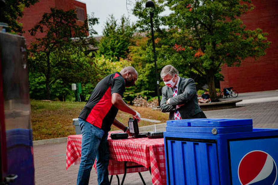 Southern Illinois University Edwardsville Chancellor Randy Pembrook inspects the chili being handed out to students and staff Wednesday. The annual SIUE Chili Cook-Off is among the few non-virtual Homecoming events scheduled for this year. Photo: Tyler Pletsch | Intelligencer