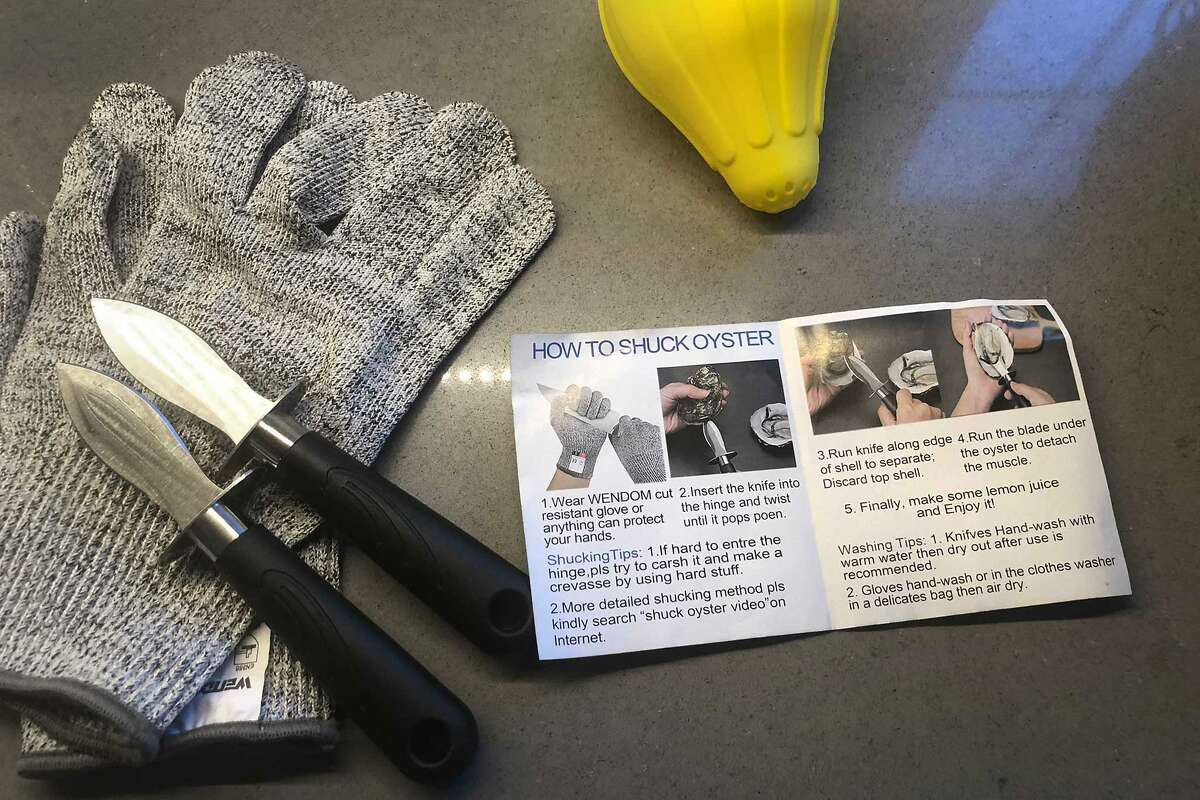 A shucking kit with a pair of gloves, a stubby knife, and a silicone sleeve for holding oysters ... everything to keep a first-time shucker safe.