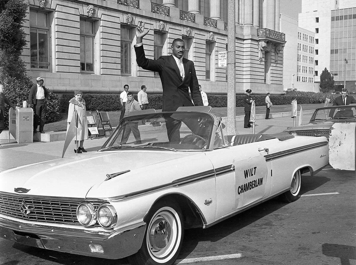 Wilt Chamberlain in front of City Hall during a parade for the San Francisco Warriors.
