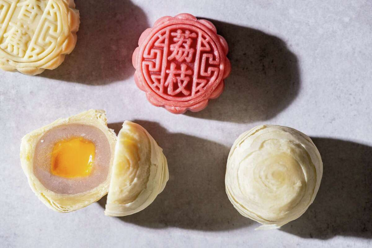The author celebrates the Moon Festival with mooncakes. MUST CREDIT: Photo by Laura Chase de Formigny for The Washington Post.
