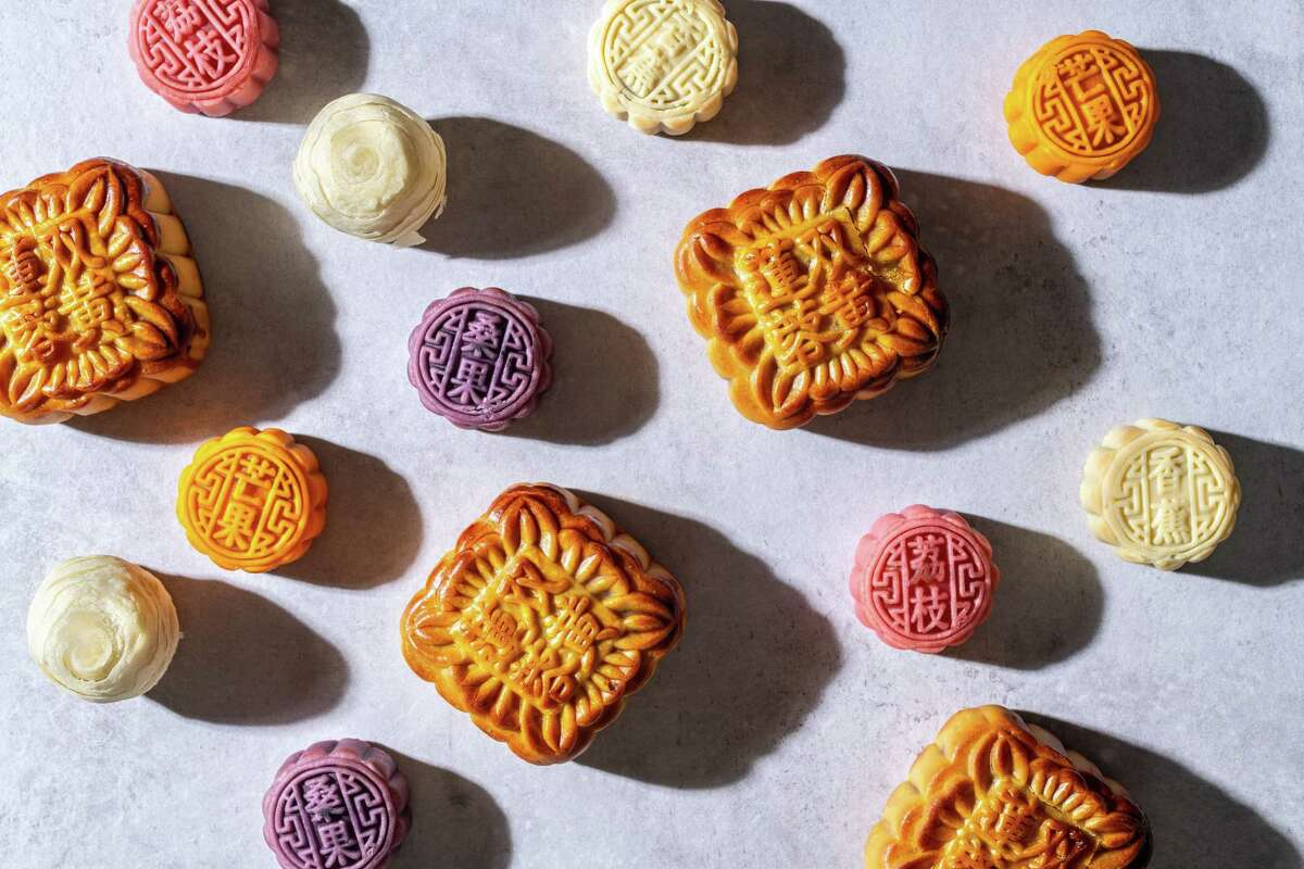 Mooncakes flavored with mulberry, banana, lychee, mango, lotus and egg yolk. MUST CREDIT: Photo by Laura Chase de Formigny for The Washington Post.