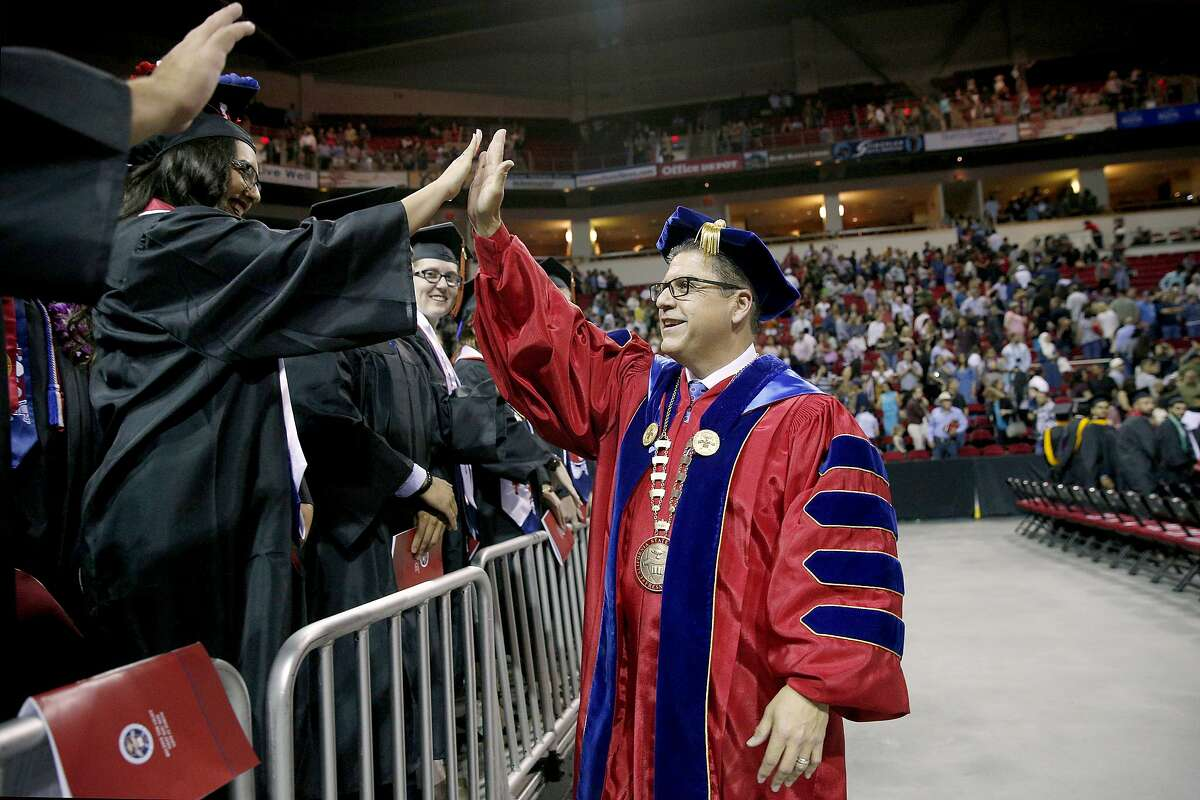 Fresno State President Dr. Joseph Castro greeting graduates during commencement ceremonies at the university in Fresno, Calif. May 19, 2018. Dr. Joseph Castro was announced as the new chancellor of the CSU system on Wednesday, Sept. 23, 2020, making him the first Mexican-American and native Californian to lead the nation's largest four-year public university system.(Cary Edmondson/California State University via AP)