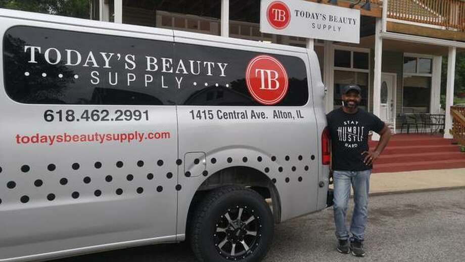 Benjamin Golley, owner of Today's Beauty Supply in Alton, shows off his new business delivery van in front of his beauty supply store on Central Street in Alton. Photo: Jeanie Stephens |The Telegraph