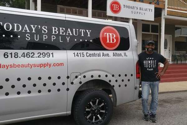 Benjamin Golley, owner of Today's Beauty Supply in Alton, shows off his new business delivery van in front of his beauty supply store on Central Street in Alton.
