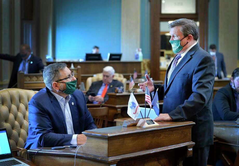Senate Appropriations Committee Chairman Jim Stamas, R-Midland, discusses school funding with K-12 budget subcommittee Chairman Wayne Schmidt, R-Traverse City, prior to the Senate finalizing the fiscal year 2021 budget on Wednesday. The budget would balance the state's deficit, increase funding for K-12 schools. fully fund the 2015 plan to help fix Michigan's roads, and boost local revenue sharing. (Photo provided)