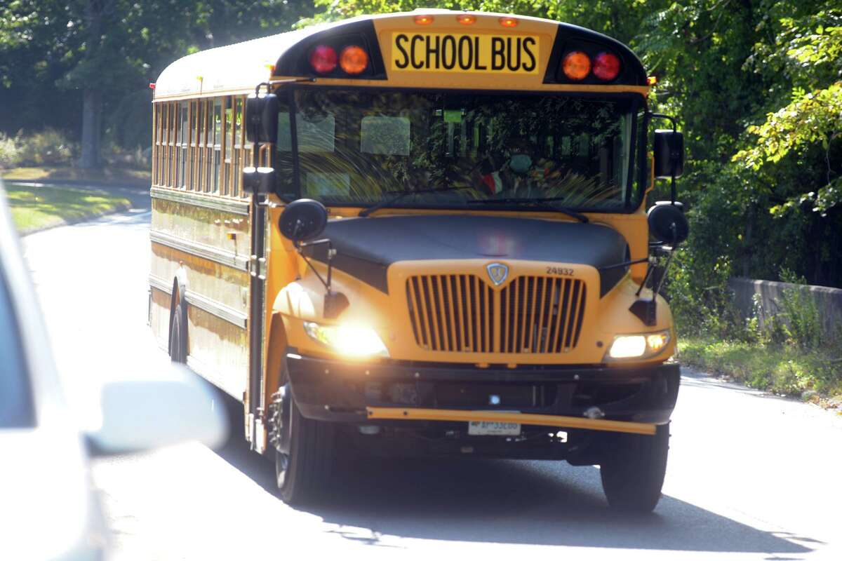 A school bus approaches the Durham School Services lot in Trumbull, Conn. Sept. 23, 2020.
