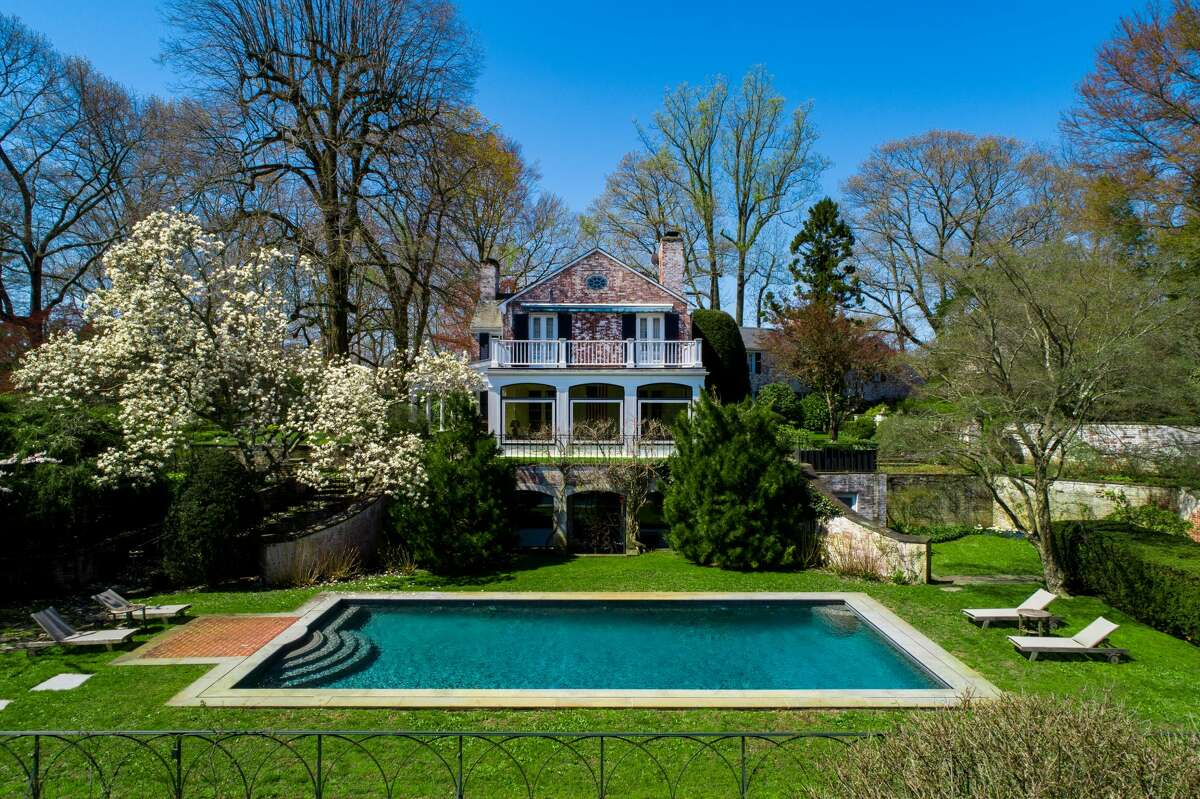 Musician Paul Simon's New Canaan, Conn. estate is on the market for $11.9 million. The grounds provide a parklike idyll with sweeping meadows, formal walled gardens and a swimming pool scenically sited on a grassy plateau with serene views over a placid private pond. Just inside the main gates and a good distance from the main house, a 2,400-square-foot cottage, which the couple used as a recording studio, makes a perfect caretaker's home or guesthouse.