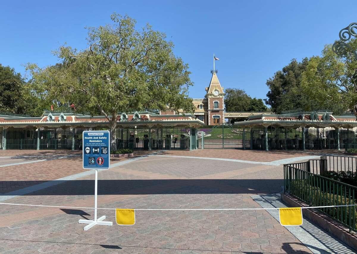 The entrance to Disneyland Park is roped off and guarded by security to keep guests from rushing the gates on September 21, 2020 in Anaheim, California.