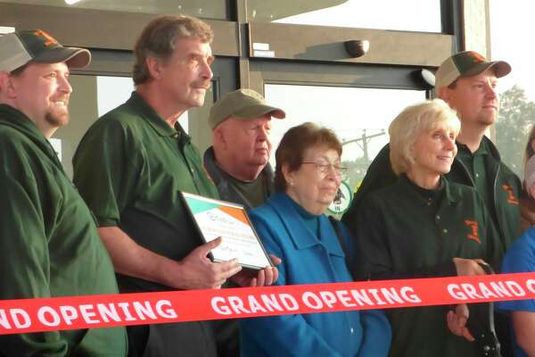 Members of the Fischer family including Dean (far left), Greg (left) and Bonnie (right) cut the ribbon to the newly rebuilt Dublin General Store Wednesday morning. (Scott Fraley/News Advocate)