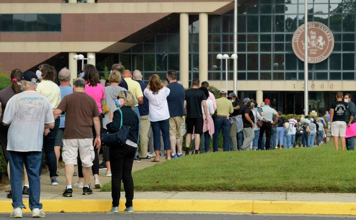 Virginia voters wait to cast their ballots at the Fairfax County Government Center on Friday, Sept. 18, 2020.