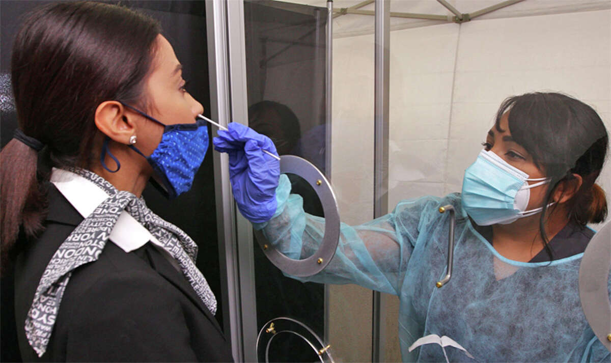 A worker is swabbed for COVID-19 testing.