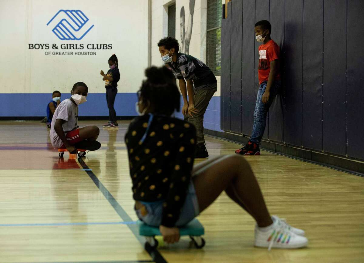 Middle school students play during an after-school program at the gym at Boys & Girls Clubs' Fort Bend site.