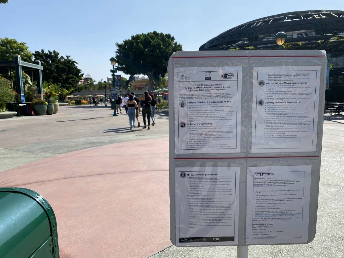 Safety precautions are posted at the entrance to Downtown Disney, and there are temperature and bag checks required to get in on September 21, 2020 in Anaheim, California.